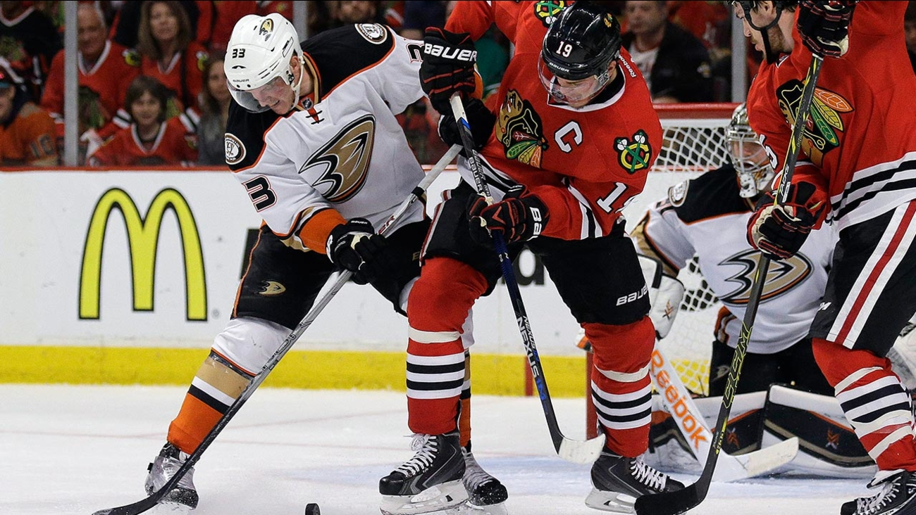 Anaheim Ducks right wing Jakob Silfverberg (33) and Chicago Blackhawks center Jonathan Toews (19) work for the puck during the second period in Game 4 of the Western Conference finals of the NHL hockey Stanley Cup playoffs, Saturday, May 23, 2015.