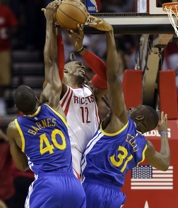 """<div class=""""meta image-caption""""><div class=""""origin-logo origin-image none""""><span>none</span></div><span class=""""caption-text"""">Rockets' Dwight Howard  is defended by Warriors' Harrison Barnes and Festus Ezeli during the first half in Game 3 of the NBA basketball Western Conference finals on May 23, 2015, i</span></div>"""