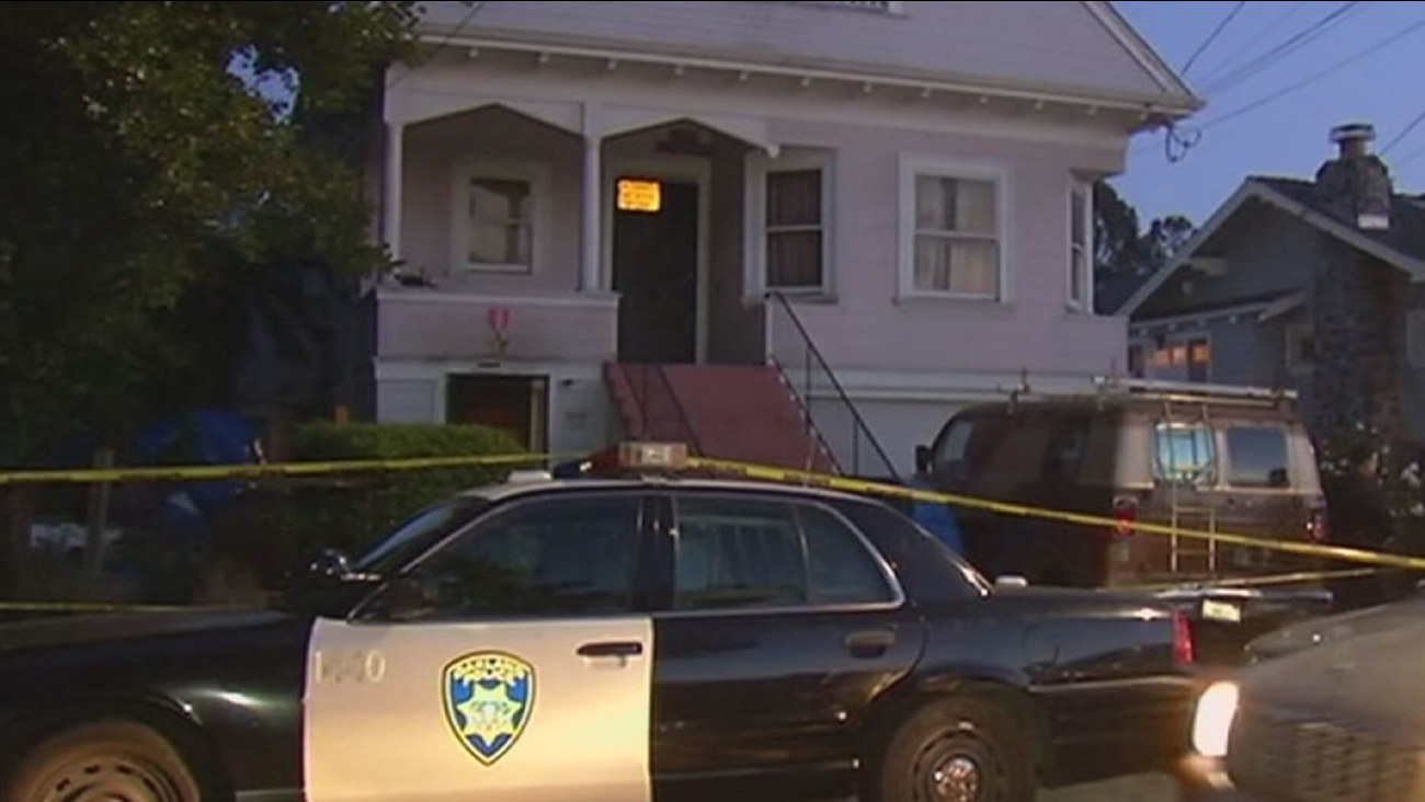 Police investigate a triple murder at a home in Oakland, Calif. on May 23, 2015.