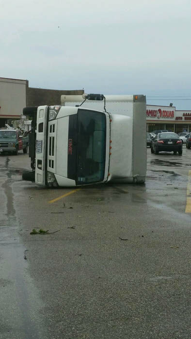 """<div class=""""meta image-caption""""><div class=""""origin-logo origin-image none""""><span>none</span></div><span class=""""caption-text"""">The winds knocked over this truck in southwest Houston (Photo/iWitness Reports)</span></div>"""