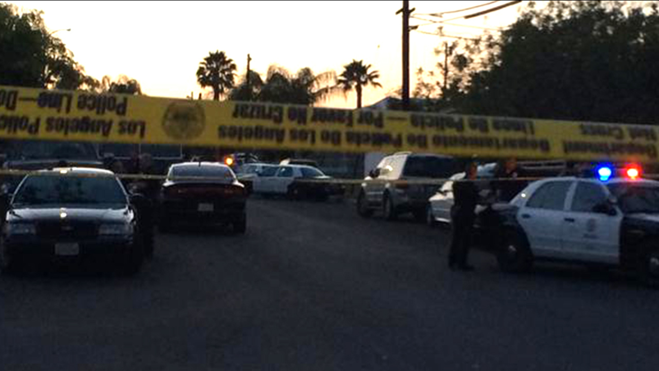 Los Angeles police investigate the scene after a man accused of threatening his girlfriend led officers on a chase that ended in front of his Sylmar home on Sunday, May 24, 2015.