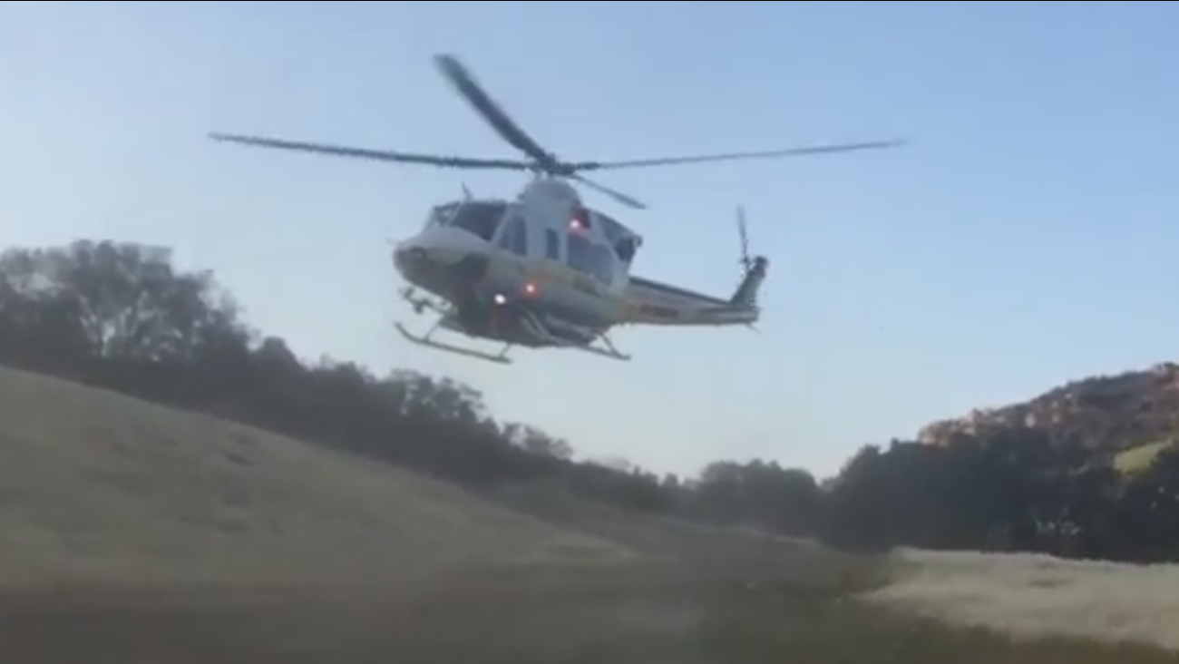 A helicopter airlifts two Los Angeles County sheriff's deputies injured in a rollover crash in Malibu on Sunday, May 24, 2015.