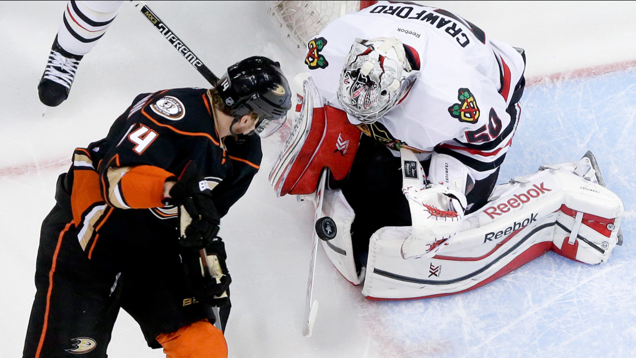 Chicago Blackhawks goalie Corey Crawford, right, blocks shot by Anaheim Ducks left wing Tomas Fleischmann in Game 5 of the Western Conf. final of the NHL playoffs on May 25, 2015.