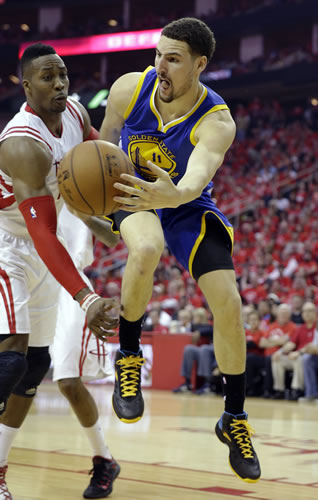 """<div class=""""meta image-caption""""><div class=""""origin-logo origin-image none""""><span>none</span></div><span class=""""caption-text"""">Golden State Warriors guard Klay Thompson (11) passes around Houston Rockets center Dwight Howard during the second half in Game 4 of the Western Conference finals. (AP Photo/David J. Phillip)</span></div>"""