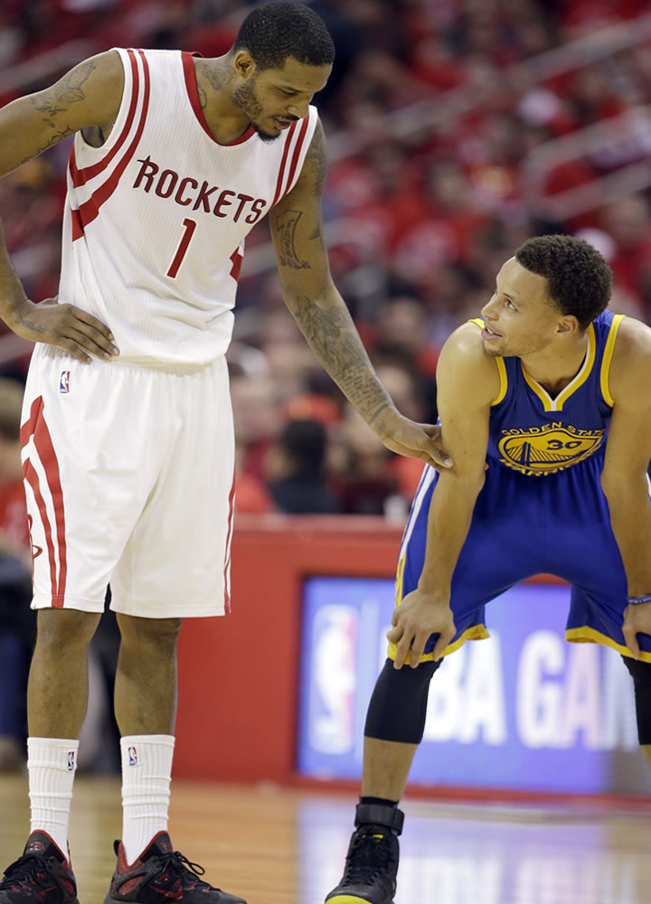 """<div class=""""meta image-caption""""><div class=""""origin-logo origin-image ap""""><span>AP</span></div><span class=""""caption-text"""">Houston Rockets' Trevor Ariza talks with Warriors guard Stephen Curry between plays during the second half in Game 4 on Monday, May 25, 2015, in Houston. (AP/David J. Phillip)</span></div>"""