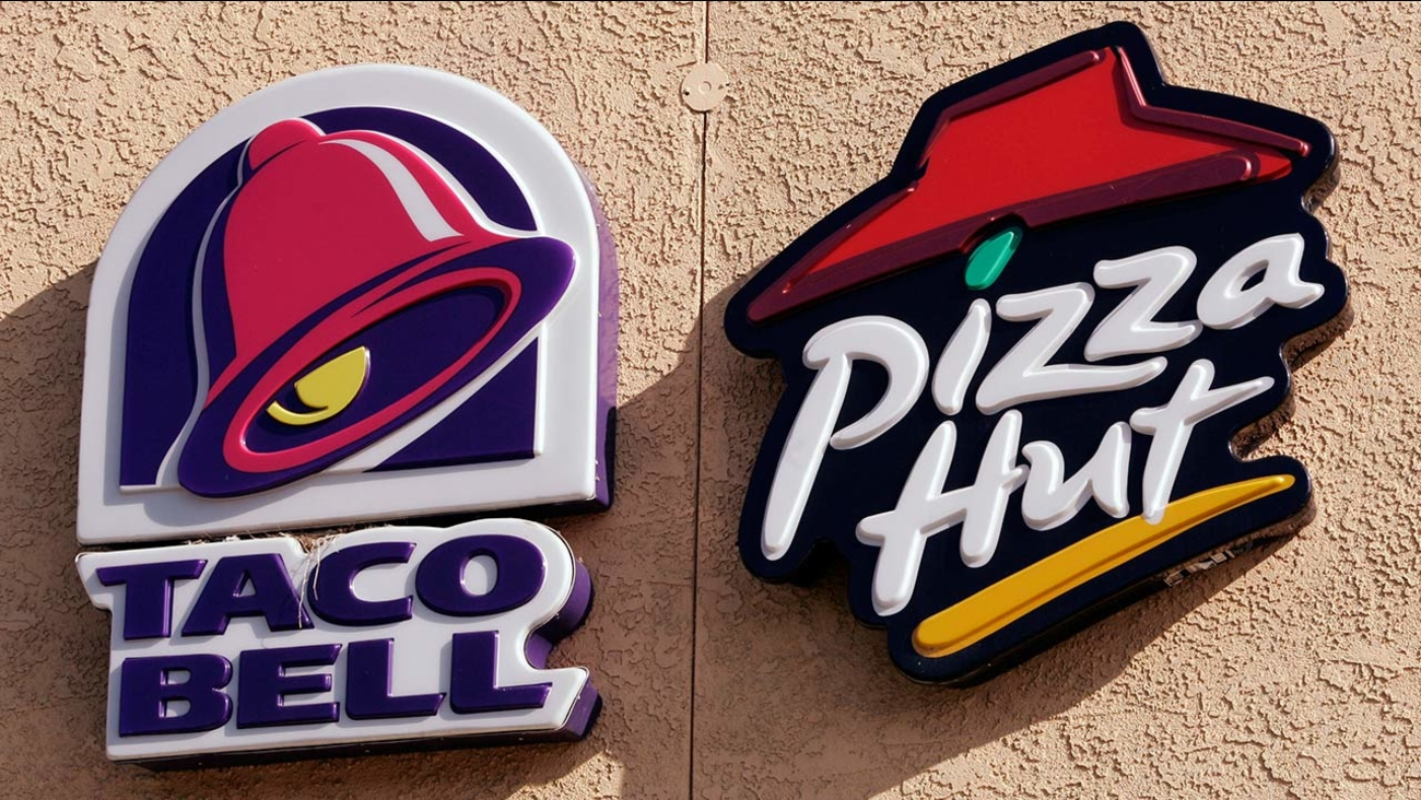 Signs for Yum Brands restaurants Taco Bell and Pizza Hut Express are shown in San Carlos, Calif.