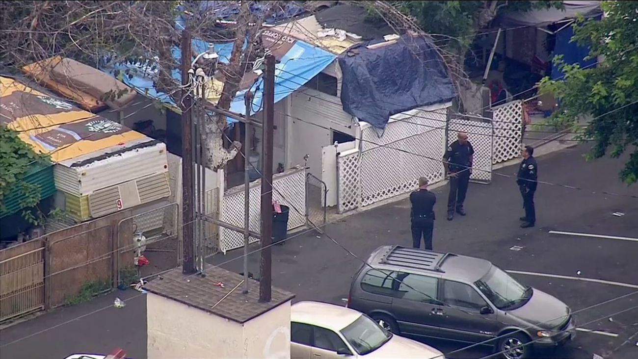 Police investigate a fatal shooting in Pomona on Tuesday, May 26, 2015.