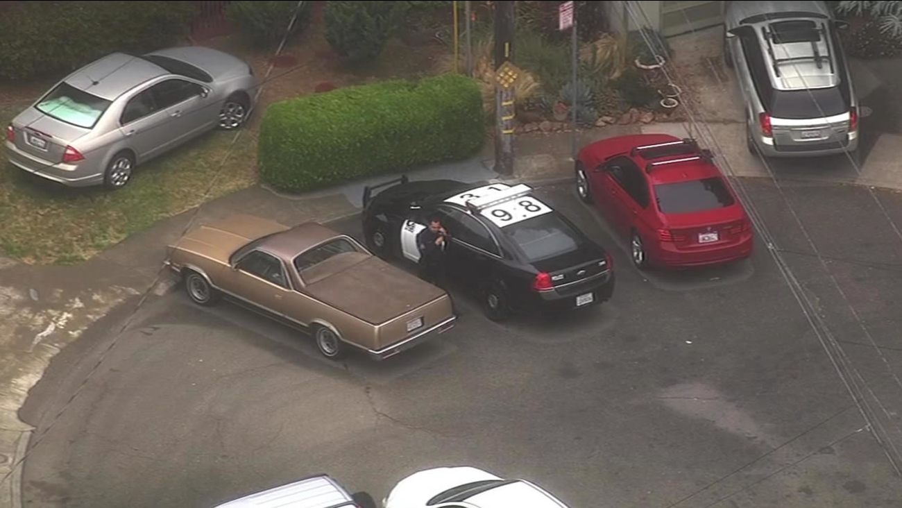Oakland police used a helicopter to arrest two suspects accused of a string of armed robberies in East Oakland on Tuesday, May 26, 2015.