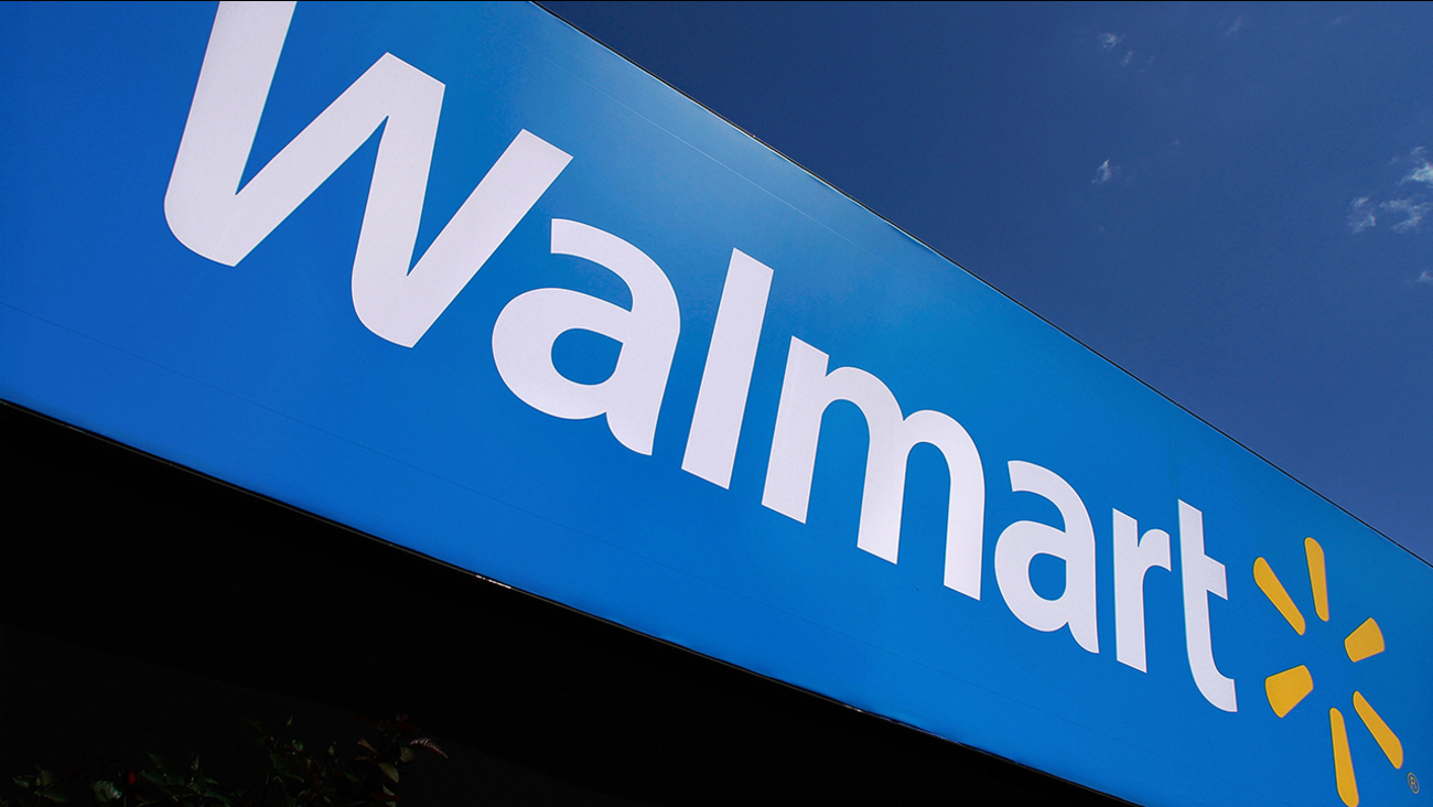 FILE - In this May 16, 2011 file photo, the Wal-Mart logo is displayed.