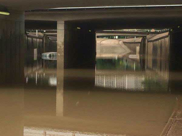 "<div class=""meta image-caption""><div class=""origin-logo origin-image none""><span>none</span></div><span class=""caption-text"">This photo shows a vehicle submerged in high water on Allen Parkway near downtown Houston. (Pooja Lodhia/Photo)</span></div>"