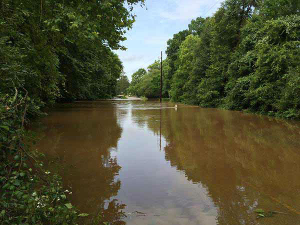 "<div class=""meta image-caption""><div class=""origin-logo origin-image none""><span>none</span></div><span class=""caption-text"">Walnut Creek is overflowing in Montgomery County, this road impassable right now, May 27, 2015. (Steve Campion/Photo)</span></div>"