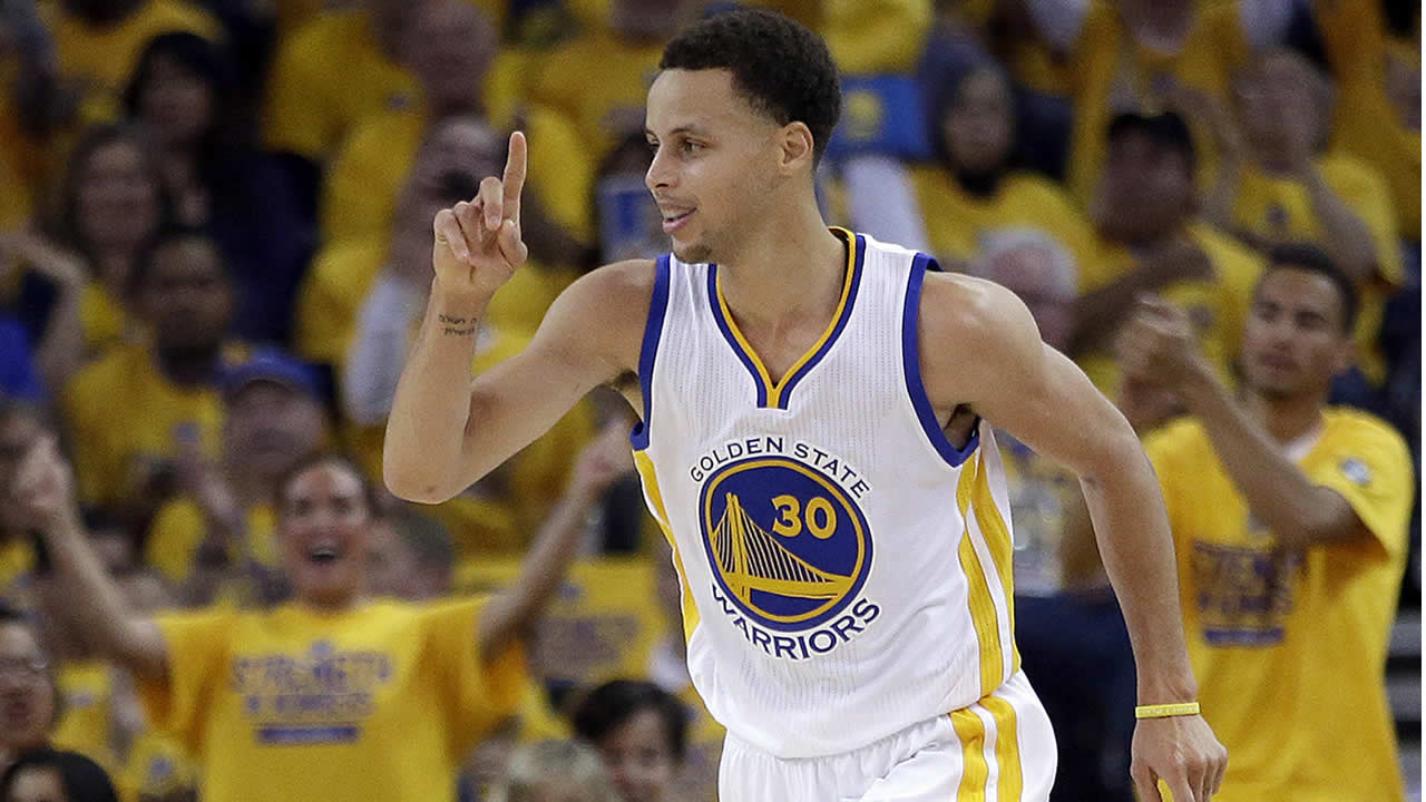 Golden State Warriors guard Stephen Curry reacts during Game 2 of the NBA basketball Western Conference finals against the Houston Rockets in Oakland, Calif., May 21, 2015. (AP Photo/Rick Bowmer)