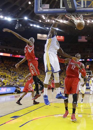 "<div class=""meta image-caption""><div class=""origin-logo origin-image ap""><span>AP</span></div><span class=""caption-text"">Golden State Warriors center Festus Ezeli, center, dunks against Houston Rockets guard Jason Terry, left, and center Dwight Howard (12) during the first half of Game 5 in Oakland. (AP Photo/Tony Avelar)</span></div>"