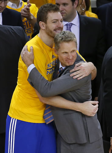 """<div class=""""meta image-caption""""><div class=""""origin-logo origin-image ap""""><span>AP</span></div><span class=""""caption-text"""">Golden State Warriors forward David Lee, left, hugs coach Steve Kerr during the second half of Game 5 of the NBA basketball Western Conference finals against the Houston Rockets. (AP Photo/Tony Avelar)</span></div>"""
