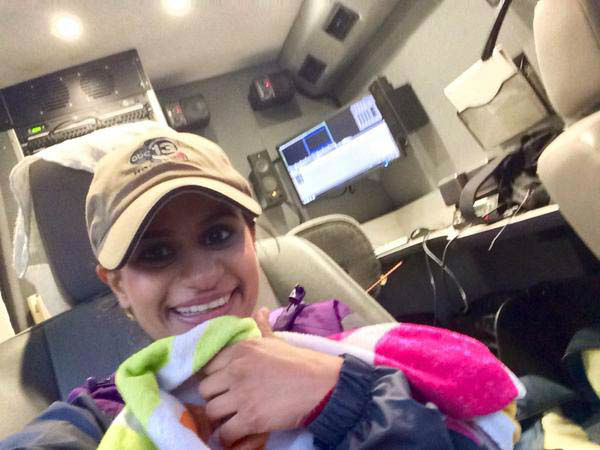"""<div class=""""meta image-caption""""><div class=""""origin-logo origin-image none""""><span>none</span></div><span class=""""caption-text"""">Pooja dried off with a towel inside the truck in between live shots (KTRK Photo)</span></div>"""