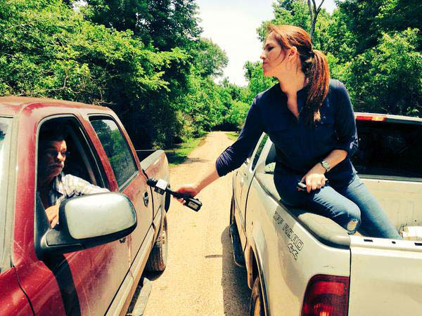 """<div class=""""meta image-caption""""><div class=""""origin-logo origin-image none""""><span>none</span></div><span class=""""caption-text"""">Natasha doing an interview from the bed of a pickup truck (KTRK Photo)</span></div>"""