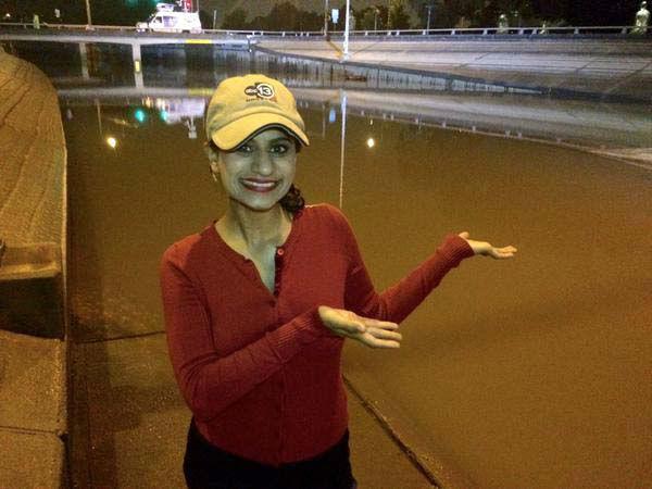 "<div class=""meta image-caption""><div class=""origin-logo origin-image none""><span>none</span></div><span class=""caption-text"">Pooja posing with flood waters (KTRK Photo)</span></div>"