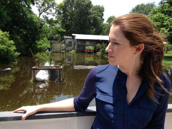 """<div class=""""meta image-caption""""><div class=""""origin-logo origin-image none""""><span>none</span></div><span class=""""caption-text"""">Natasha riding around assessing the flood damage (KTRK Photo)</span></div>"""