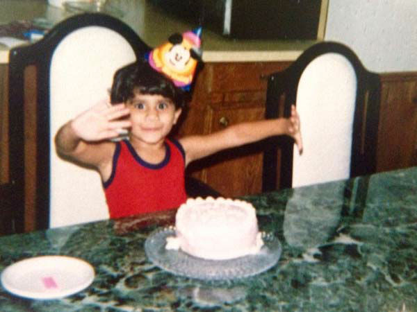 <div class='meta'><div class='origin-logo' data-origin='none'></div><span class='caption-text' data-credit='KTRK Photo'>Pooja Lodhia celebrating a birthday as a kid</span></div>