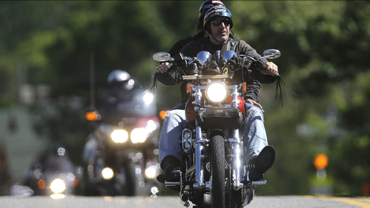 Motorcyclists ride along Canada Street during the Americade motorcycle rally on Wednesday, June 5, 2013, in Lake George, N.Y. (AP Photo/Mike Groll)