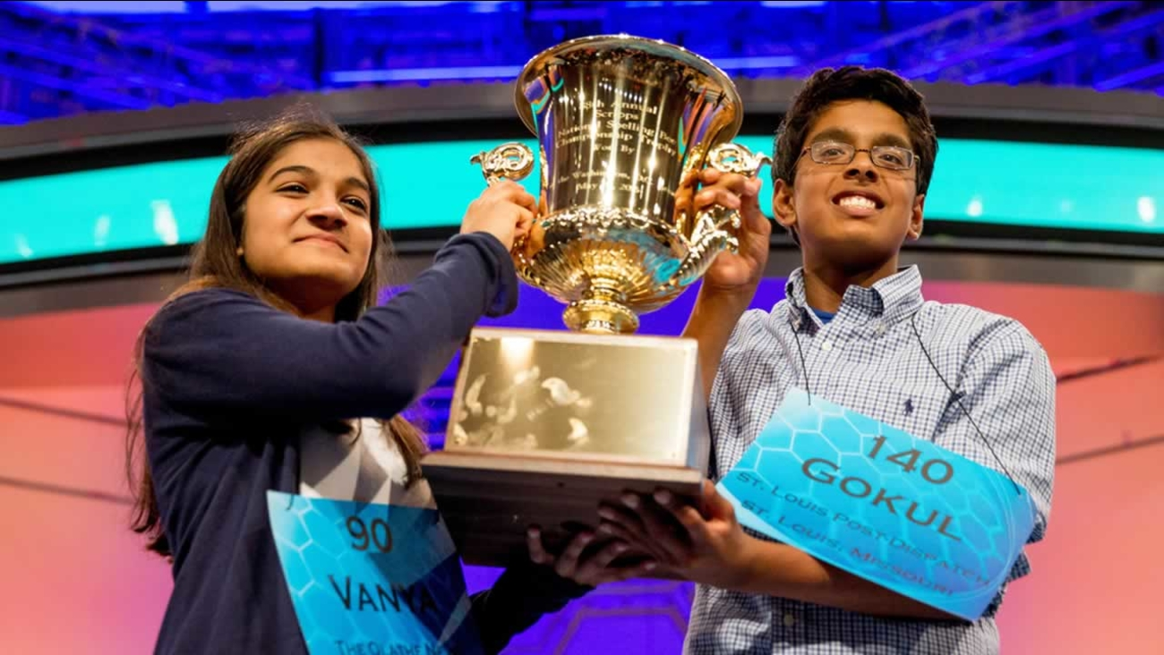 Vanya Shivashankar, left, 13, and Gokul Venkatachalam, 14, hold up the championship trophy as co-champions of  the Scripps National Spelling Bee on Thursday, May 28, 2015.