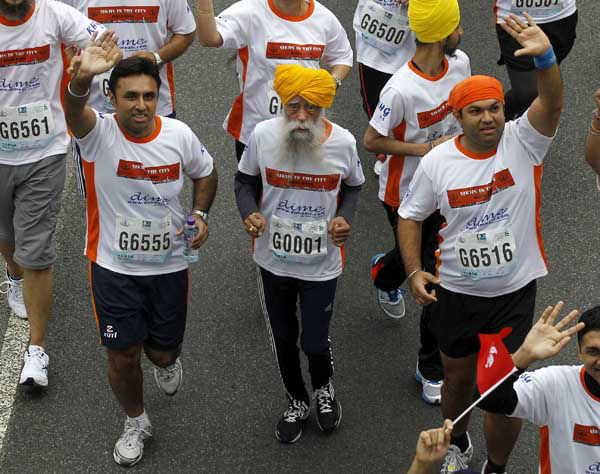 "<div class=""meta image-caption""><div class=""origin-logo origin-image ""><span></span></div><span class=""caption-text"">Centenarian marathon runner Fauja Singh, 101, center, runs in a 10-kilometer race, part of the annual Hong Kong Marathon 2/24/13, he then retired from racing. (AP Photo/ Kin Cheung)</span></div>"