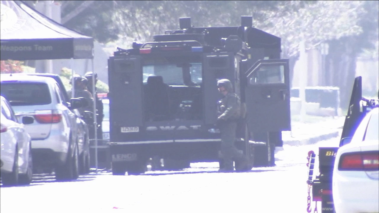 A SWAT team responds to a barricaded man in a Rialto house on Friday, May 29, 2015.