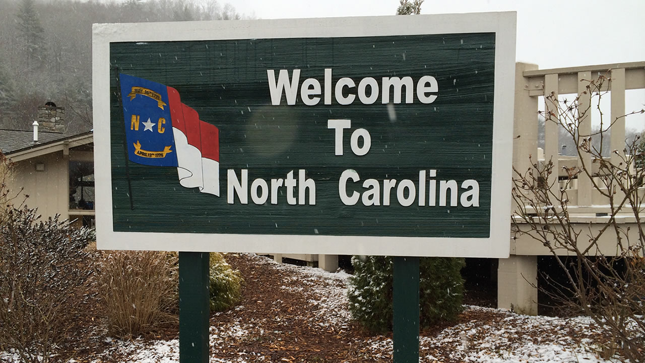Welcome to North Carolina sign with snow