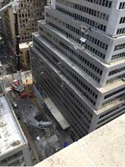 """<div class=""""meta image-caption""""><div class=""""origin-logo origin-image none""""><span>none</span></div><span class=""""caption-text"""">A crane trying to lift an air-conditioning unit dropped it Sunday morning at a building on Madison Avenue. (Photo courtesy @nickgenes)</span></div>"""