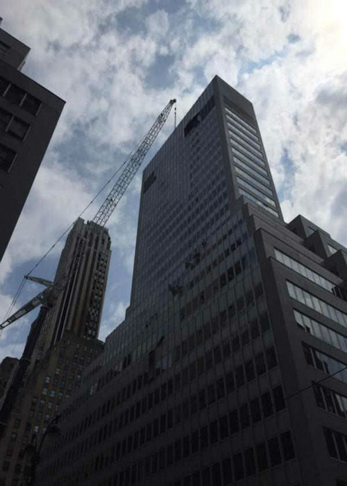 """<div class=""""meta image-caption""""><div class=""""origin-logo origin-image none""""><span>none</span></div><span class=""""caption-text"""">A crane trying to lift an air-conditioning unit dropped it Sunday morning at a building on Madison Avenue.</span></div>"""