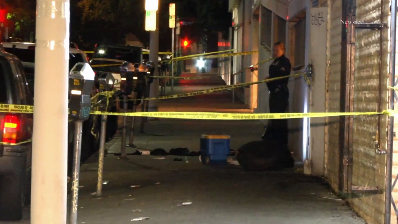 Crime scene tape ropes off the scene of an officer-involved shooting in the 600 block of Coronado Street in Los Angeles' Westlake District.