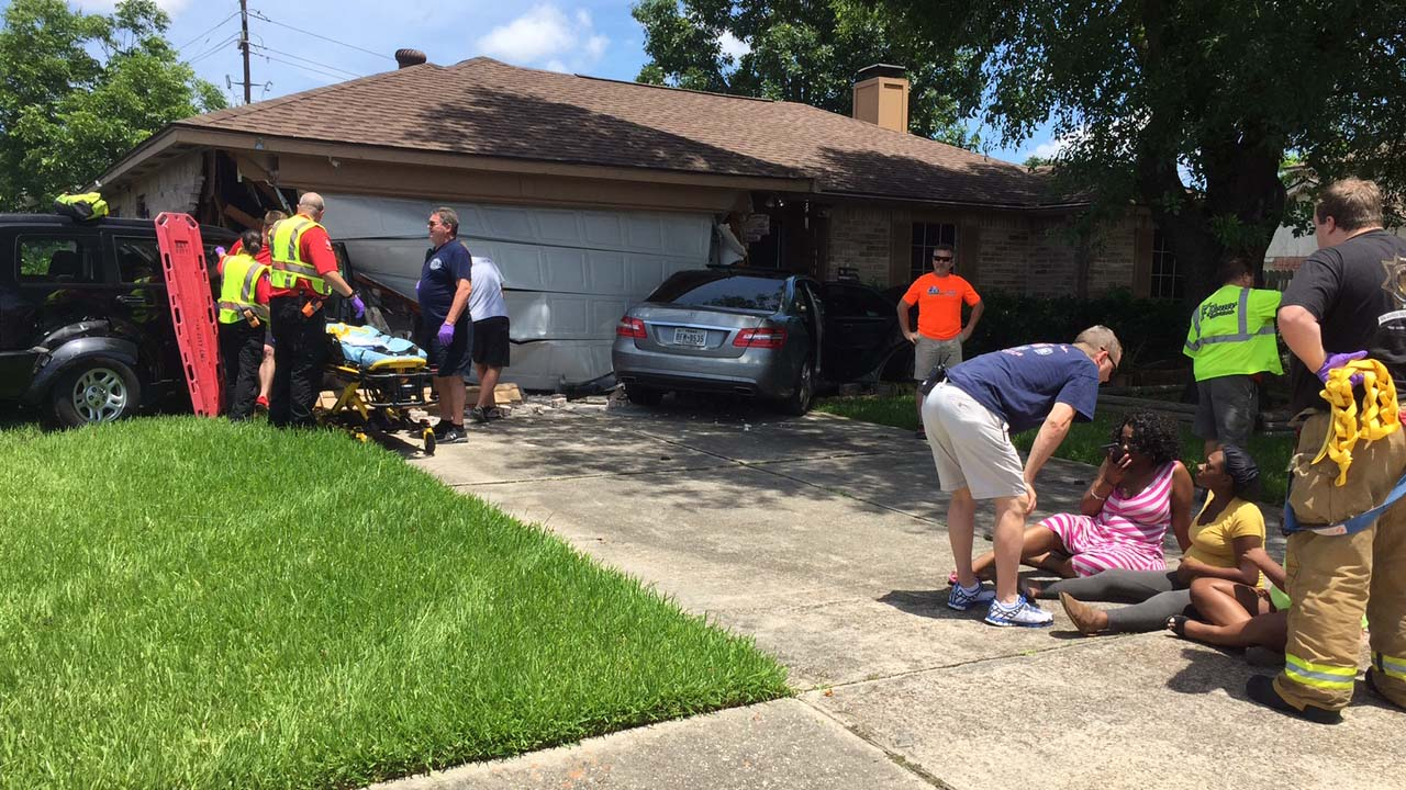 The scene where two cars crashed into the side of a house in north Houston
