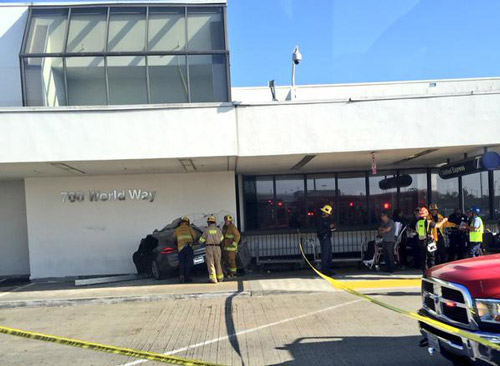 "<div class=""meta image-caption""><div class=""origin-logo origin-image kabc""><span>KABC</span></div><span class=""caption-text"">Firefighters assess the damage to a wall at the Los Angeles International Airport after a car crashed into it on Sunday, May 31, 2015. (Kristina Monllos)</span></div>"