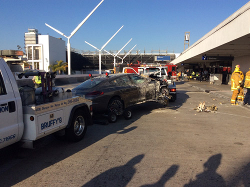"<div class=""meta image-caption""><div class=""origin-logo origin-image kabc""><span>KABC</span></div><span class=""caption-text"">A gray sedan is towed away after it crashed into the departure level of Terminal 7 at Los Angeles International Airport on Sunday, May 31, 2015. (LAFD Photo 