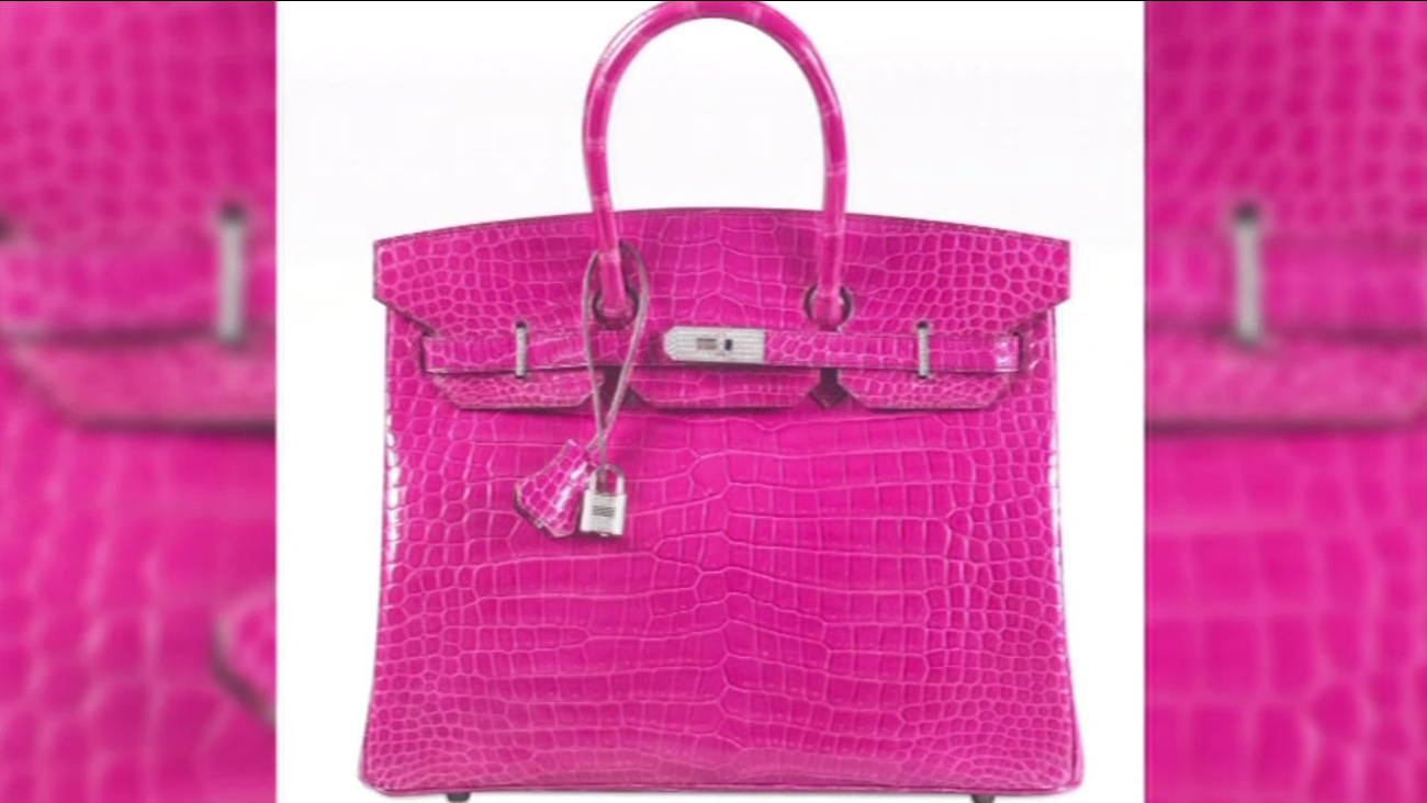 A diamond-encrusted Birkin Bag sold at a Christie's auction house in Hong Kong for a record $222,000 on June 1, 2015.