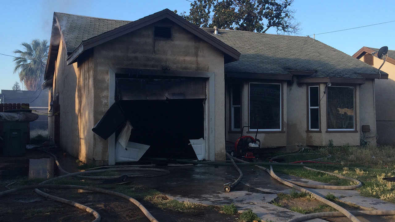 House fire near Olive Avenue and Cedar Avenue.