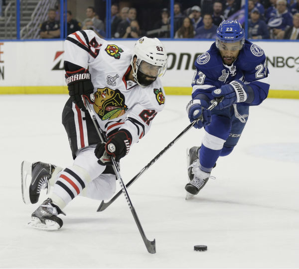 """<div class=""""meta image-caption""""><div class=""""origin-logo origin-image none""""><span>none</span></div><span class=""""caption-text"""">Tampa Bay Lightning right wing J.T. Brown battles Chicago Blackhawks defenseman Johnny Oduya for the puck, during the first period in Game 1 of the NHL hockey Stanley Cup Final. (Photo/Chris O'Meara)</span></div>"""