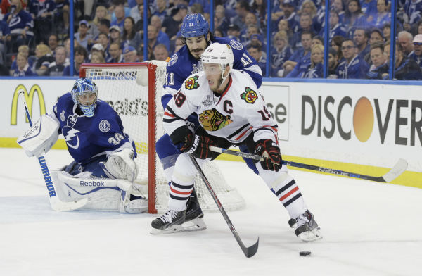 """<div class=""""meta image-caption""""><div class=""""origin-logo origin-image none""""><span>none</span></div><span class=""""caption-text"""">Chicago Blackhawks center Jonathan Toews skates around Tampa Bay Lightning center Brian Boyle as goalie Ben Bishop defends the net in Game 1 of the NHL hockey Stanley Cup Final. (Photo/Chris O'Meara)</span></div>"""