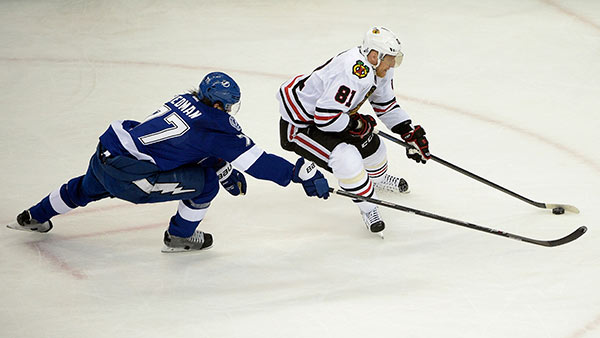 """<div class=""""meta image-caption""""><div class=""""origin-logo origin-image none""""><span>none</span></div><span class=""""caption-text"""">Chicago Blackhawks Marian Hossa skates past Tampa Bay Lightning defenseman Victor Hedman during the first period in Game 1 of the NHL hockey Stanley Cup Final. (AP Photo/ Phelan M. Ebenhack)</span></div>"""