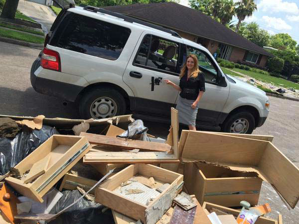 """<div class=""""meta image-caption""""><div class=""""origin-logo origin-image none""""><span>none</span></div><span class=""""caption-text"""">Christine Dobbyn and her photographer used a GoPro attached to the side of the SUV to get footage of storm cleanup (KTRK Photo)</span></div>"""
