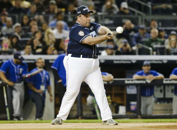 "<div class=""meta image-caption""><div class=""origin-logo origin-image none""><span>none</span></div><span class=""caption-text"">New Jersey Gov. Chris Christie bats during the first inning of the ""True Blue"" benefit celebrity softball game at Yankee Stadium (AP Photo/ Frank Franklin II)</span></div>"