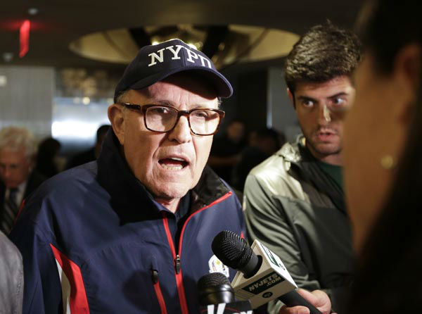 "<div class=""meta image-caption""><div class=""origin-logo origin-image none""><span>none</span></div><span class=""caption-text"">Former New York City Mayor Rudy Giuliani responds to questions before the ""True Blue"" benefit celebrity softball game at Yankee Stadium (AP Photo/ Frank Franklin II)</span></div>"