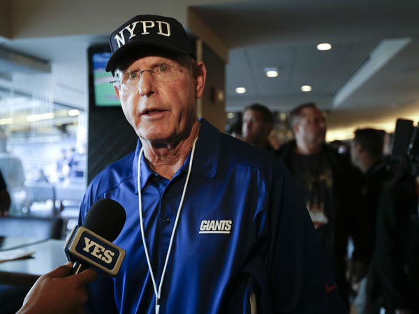 "<div class=""meta image-caption""><div class=""origin-logo origin-image none""><span>none</span></div><span class=""caption-text"">New York Giants head coach Tom Coughlin responds to questions before the ""True Blue"" benefit celebrity softball game at Yankee Stadium (AP Photo/ Frank Franklin II)</span></div>"