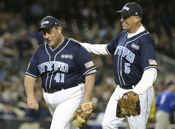 "<div class=""meta image-caption""><div class=""origin-logo origin-image none""><span>none</span></div><span class=""caption-text"">New Jersey Gov. Chris Christie, left and Buffalo Bills coach Rex Ryan, right, celebrate as they head to the dugout during the first inning (AP Photo/ Frank Franklin II)</span></div>"