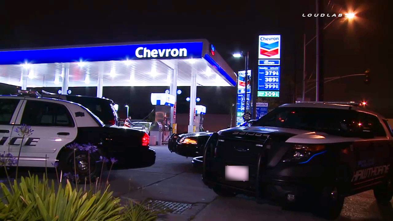 Patrol vehicles are shown near a Chevron gas station in Hawthorne following a robbery on Thursday, June 4, 2015.