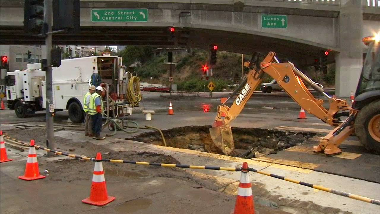 Crews work to repair a sinkhole caused by a water-main break in Echo Park.