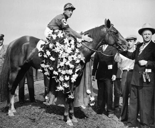 "<div class=""meta image-caption""><div class=""origin-logo origin-image none""><span>none</span></div><span class=""caption-text"">Whirlaway is draped with the floral tribute in the winner's circle on June 7, 1941 after winning the Belmont Stakes race with jockey Eddie Arcaro. (AP Photo) (AP Photo/ XSS SAV)</span></div>"