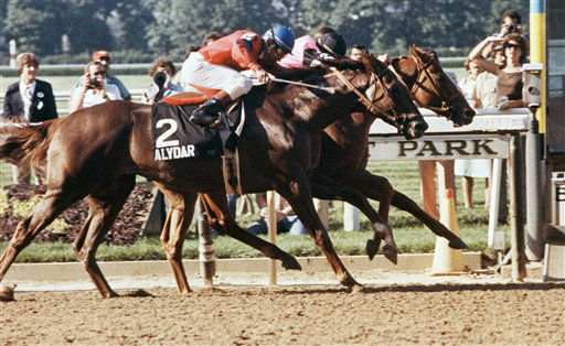 "<div class=""meta image-caption""><div class=""origin-logo origin-image none""><span>none</span></div><span class=""caption-text"">With Steve Cauthen in the saddle, Affirmed captures the Belmont Stakes with a narrow victory over Alydar in June 1978 in Elmont, New York to gain the Triple Crown. (AP Photo) (AP Photo/ ID DP, CB. KEY V, RE.   XCJ)</span></div>"