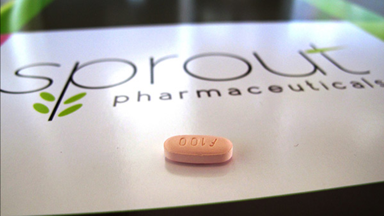 In this Friday, Sept. 27, 2013, file photo, a tablet of flibanserin sits on a brochure for Sprout Pharmaceuticals in the company's Raleigh, N.C., headquarters.