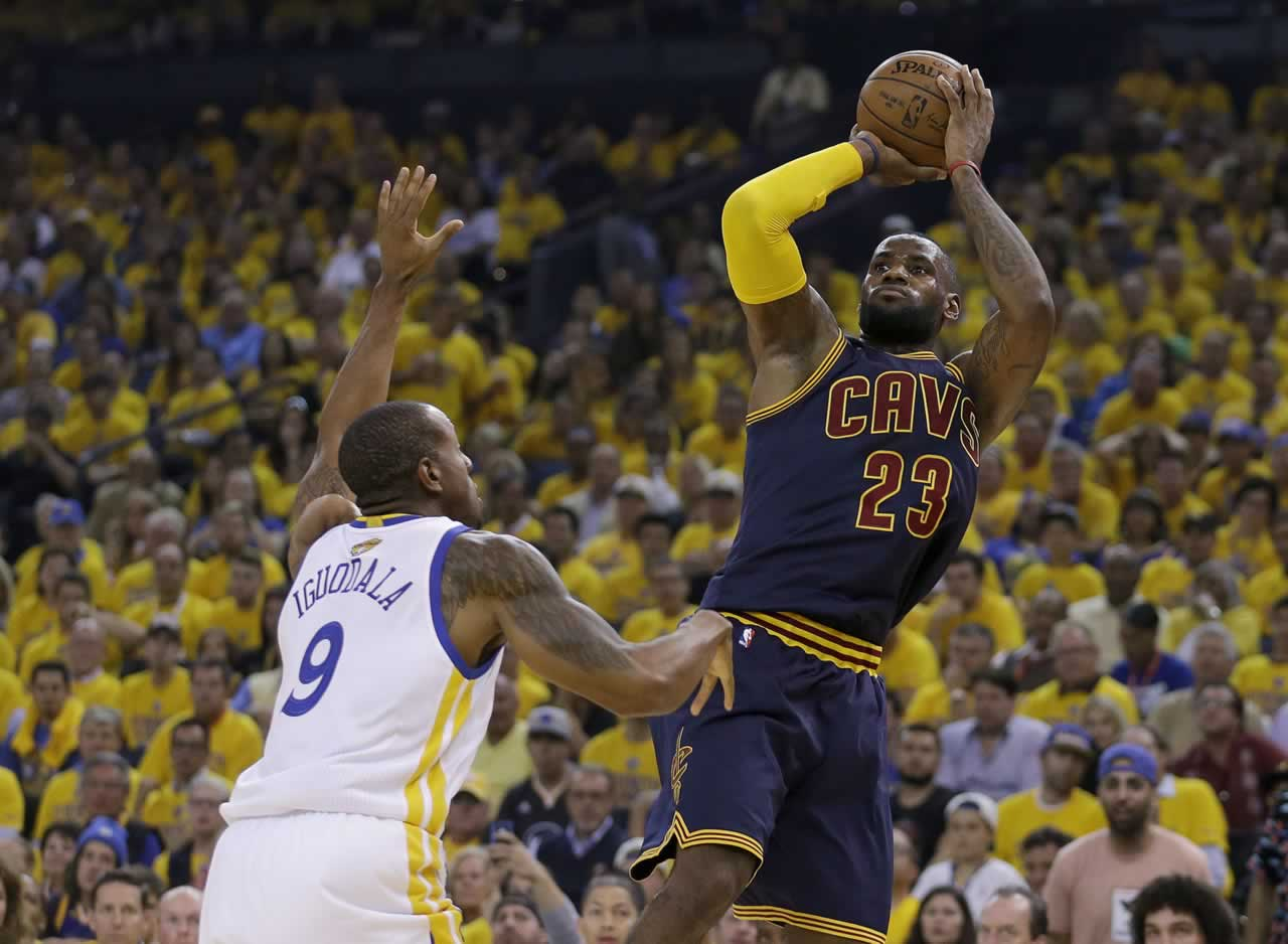 """<div class=""""meta image-caption""""><div class=""""origin-logo origin-image none""""><span>none</span></div><span class=""""caption-text"""">Cavaliers forward LeBron James shoots against Warriors forward Andre Iguodala during the first half of Game 1 of basketball's NBA Finals in Oakland, Calif., Thursday, June 4, 2015. (AP Photo/Ben Margot)</span></div>"""